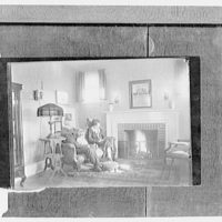 Miscellaneous subjects. Copy photograph of family on couch watching fire in fireplace