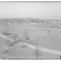Miscellaneous subjects. Elevated view of road through a landscape