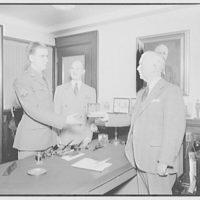 Mr. McLachlen and son, also Mr. Button of Schick Razor Co. Son receiving a Schick razor II