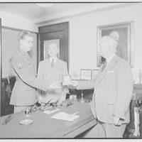Mr. McLachlen and son, also Mr. Button of Schick Razor Co. Son receiving a Schick razor I