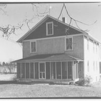 Mrs. J.W. Miller and her home, Sergent Rd., Maryland. Exterior of Mrs. Miller's house