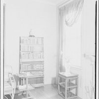 Mrs. Little, quarters in Marine Barracks. Bookshelves and window in corner