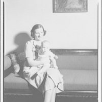 Mrs. MacGee. Mrs. MacGee seated with son on couch II
