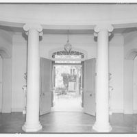 Mrs. Moran home at 2320 Bancroft. View through columns and door of Mrs. Moran's home to outdoors