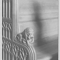 National Cathedral interiors. Carved lion at end of bench in National Cathedral