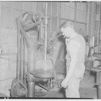 Noland Plumbing Co., Inc. Man working at steaming machinery