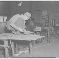 Noland Plumbing Co., Inc. Man working on table