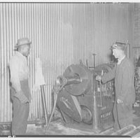 Noland Plumbing Co., Inc. Two men and machinery