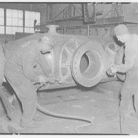 Noland Plumbing Co., Inc. Two men working on machinery