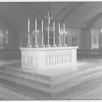 Plaster models of the Christ figure for the Catholic Council Building. Altar with candles and crucifix I