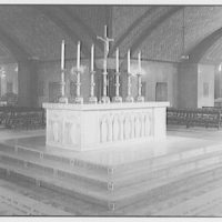 Plaster models of the Christ figure for the Catholic Council Building. Altar with candles and crucifix II