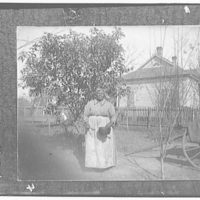 Portrait photographs. Copy photograph of woman wearing kerchief with pan and spoon in hand