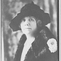Portrait photographs. Head and shoulders of woman wearing a hat and furs II