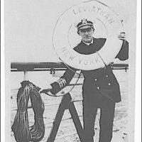 Portrait photographs. Photograph of captain of Leviathan holding lifesaver