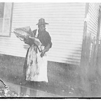 Portrait photographs. Woman in hat and apron