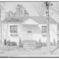 Potomac Electric Power Co. apartments and kitchens. Frontal view of a small white house