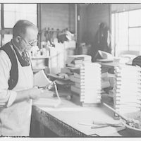 Printing shops in Washington for Stanford Paper Co. Man binding books II