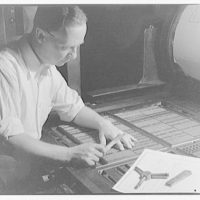 Printing shops in Washington for Stanford Paper Co. Man working at printing press XII