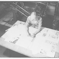 Printing shops in Washington for Stanford Paper Co. Man working on printed material at large table II
