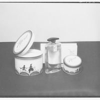 Product photographs. Perfume bottle and powder puff canister II
