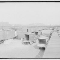 Railroads. Railroad yard with trucks and railroad cars I