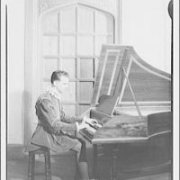Shakespearean players. Costumed man at piano II