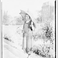 Theodor Horydczak and family. Fritzie Horydczak standing outside with parasol