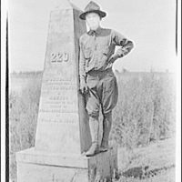 Theodor Horydczak and family. Theodor Horydczak in uniform standing next to U.S.-Mexico boundary marker