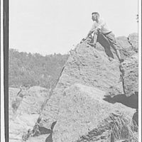 Theodor Horydczak and family. Theodor Horydczak on rocks in Great Falls area