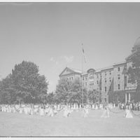 Trinity College. Women in gowns with garlands on Trinity College campus III