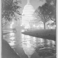 U.S. Capitol exteriors. Dome of U.S. Capitol at night with reflection II