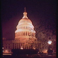 U.S. Capitol exteriors. Night view of U.S. Capitol, vertical