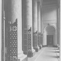U.S. Supreme Court interiors. Columns and grille gates along hall in U.S. Supreme Court