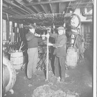 W.T. Weaver & Sons, business at 1208 Wisconsin Ave. N.W. Two men fiting pipe