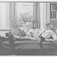 Wyckoff children. Two boys reading on couch III