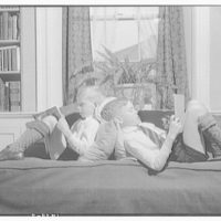 Wyckoff children. Two boys reading on couch IV