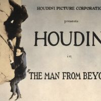 """[Houdini and man on cliff in scene from """"The man from beyond""""]"""
