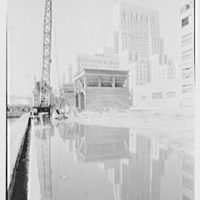 New York city views. New York Hospital, reflected in puddle