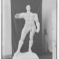Gaston Lachaise sculpture at 42 Washington Mews, New York City. Heroic man, black background