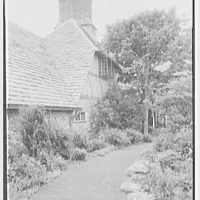 John Russell Pope, residence in Newport, Rhode Island. Service wing, chimney and garden