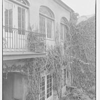 New Orleans photographs. Courtyard of 731 Royal St., fanlight windows