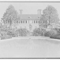 Howard Phipps, residence in Westbury, Long Island. East garden facade from pool