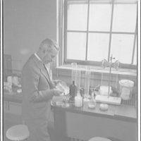 Dr. Parran, Surgeon General, U.S. Public Health Service. Dr. Parran examining equipment in lab I