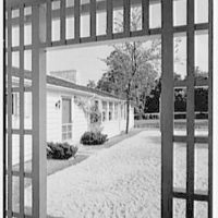 Arthur W. Rossiter, Jr., residence on St. Marks Lane, Islip, Long Island. Detail of entrance facade, through grille