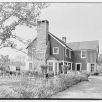 C. Maury Jones, residence in Peapack, New Jersey. Chimney and rear over garden
