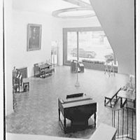 Hammond Organ Company, business at 50 W. 57th St., New York City. Main showroom, down shot, from stairs
