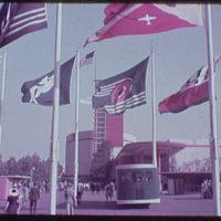 World's Fair. Chrysler Motors Building, viewed through flags