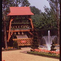 World's Fair. Holland Pavilion garden, structure with bells and fountain