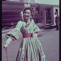 World's Fair, railroad pageant. Woman in costume with pink waistband