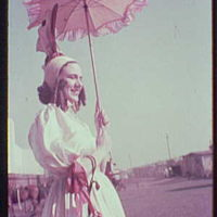 World's Fair, railroad pageant. Woman with pink bonnet and parasol